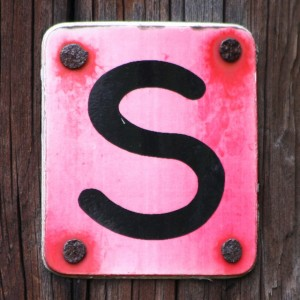 The letter S on pink plaque