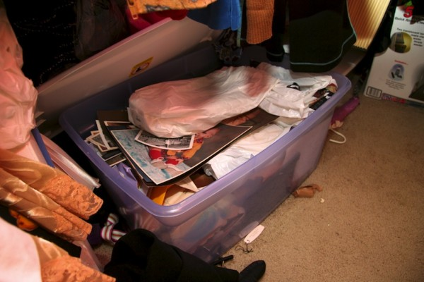 Plastic bin full of photos that need scanning