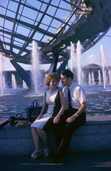 Couple posed in front of globe at 1964 World's Fair