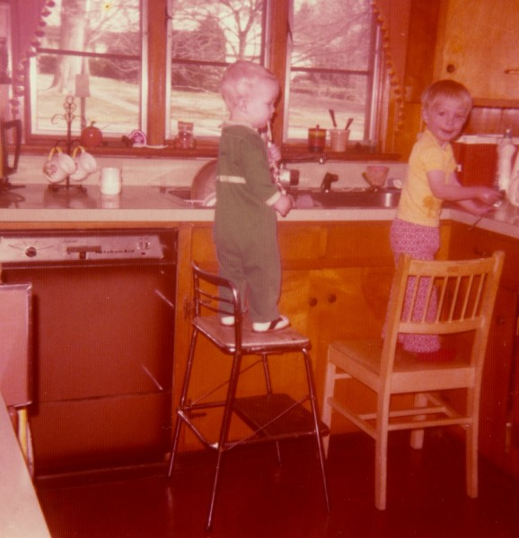 My brother and I as kids working in the kitchen on high chairs!