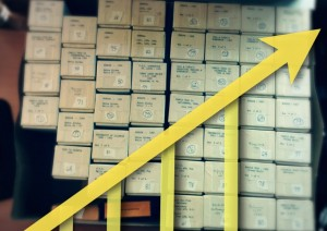 Boxes of slides with rising graph on top - Scanning Progress Report