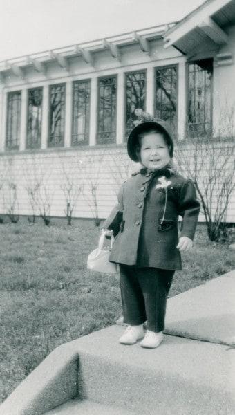 Little girl dressed up posing on front sidewalk