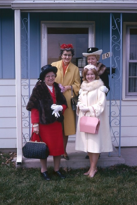 Four ladies completely dressed up to go out on the town back in the 1960's.