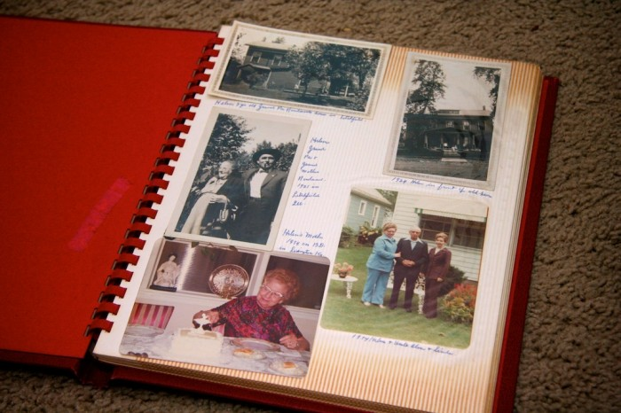 personal photo album open with hand-written captioned photos