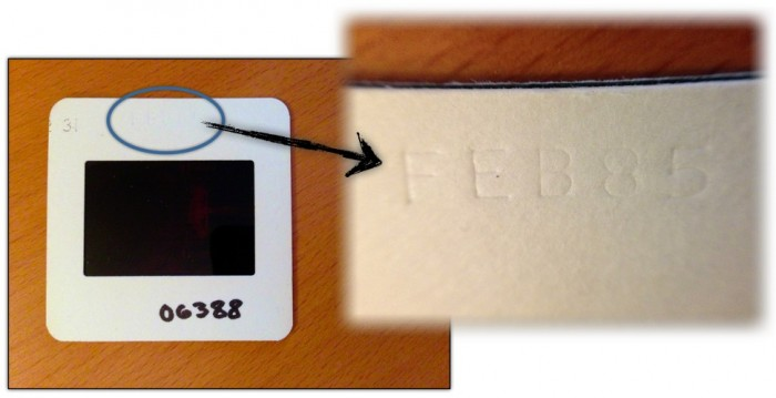 Blowup image of the photo processing date stamped into a 35 mm slide mount