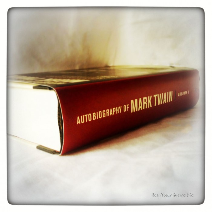 How to Write an Autobiography - Autobiography of Mark Twain Volume 1 book on its side