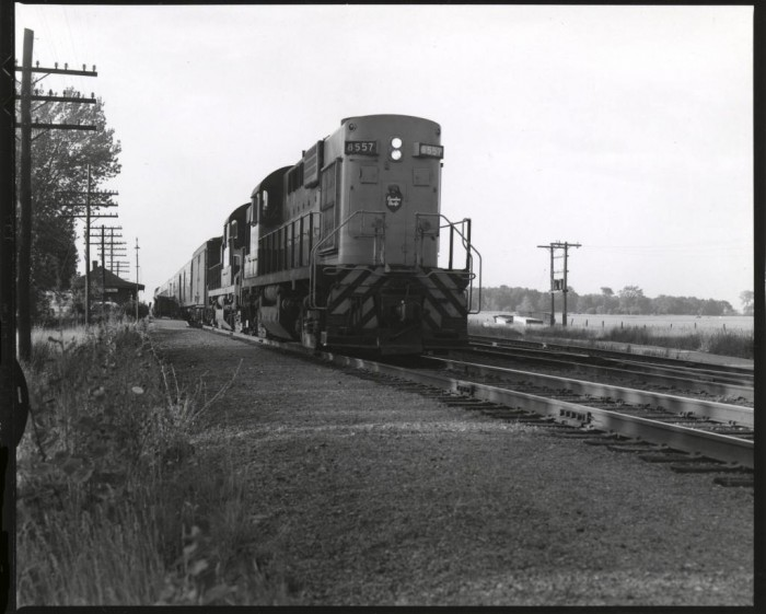 """4 x 5"""" contact print of CPR 8557 and train departing Locust Hill, Ontario, on a summer evening"""
