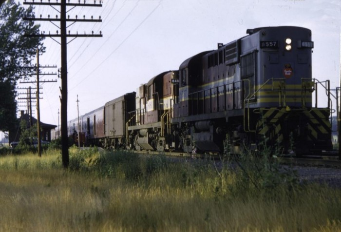 35 mm color slide of CPR 8557 and train departing Locust Hill, Ontario, on a summer evening