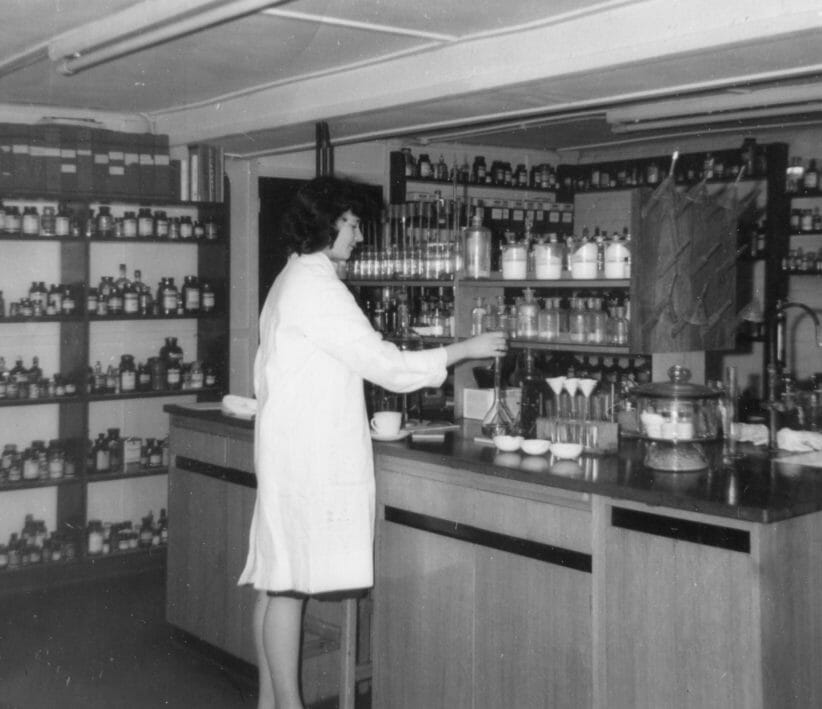 woman working in laboratory with photographic chemicals