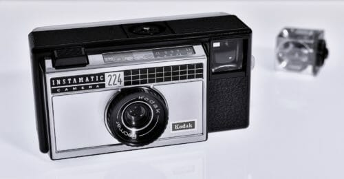 old Kodak Instamatic 224 film camera with flash bulb lying to the side