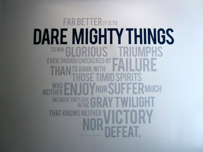 """Quote painted on wall: """"Far better it is to dare mighty things, to win glorious triumphs, even though  checkered by failure, than to rank with those poor spirits who neither enjoy much nor suffer much, because they live in the gray twilight that knows not victory nor defeat."""""""